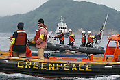 WATCHED BY JAPANESE POLICE ,GREENPEACE SHIP 'ARCTIC SUNRISE' AND INFLATABLES PROTEST IN UCHIURA BAY, BESIDE THE TAKAHAMA NUCEAR PLANT, AS BNFL SHIP 'PACIFIC PINTAIL' ARRIVES EARLY MORNING FOR RETRIEVAL OF REJECTED PLUTONIUM MOX FUEL, FOR SHIPMENT BACK TO THE UNITED KINGDOM. TAKAHAMA, JAPAN. 04/07/02. .PIC &copy; JEREMY SUTTON-HIBBERT/GREENPEACE 2002..*****ALL RIGHTS RESERVED. RIGHTS FOR ONWARD TRANSMISSION OF ANY IMAGE OR FILE IS NOT GRANTED OR IMPLIED. CHANGING COPYRIGHT INFORMATION IS ILLEGAL AS SPECIFIED IN THE COPYRIGHT, DESIGN AND PATENTS ACT 1988. THE ARTIST HAS ASSERTED HIS MORAL RIGHTS. *******