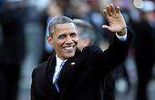 United States President Barack Obama waves as the presidential inaugural parade winds through the nation's capital January 21, 2013 in Washington, DC. Barack Obama was re-elected for a second term as President of the United States..Credit: Chip Somodevilla / Pool via CNP
