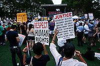 People attend a rally for the first anniversary of the death of Eric Garner in Brooklyn New York 07/18/2015. Kena Betancur/VIEWpress