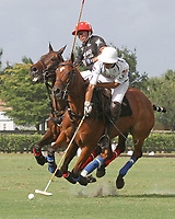 WELLINGTON, FL - APRIL 15: Pablo Spinacci of Valiente (white helmet) reaches with his mallet to take control of the ball in the $100,000 World Cup Final, at the Grand Champions Polo Club, on April 15, 2017 in Wellington, Florida. (Photo by Liz Lamont/Eclipse Sportswire/Getty Images)