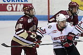 Matt Price (Boston College - 25), Rob Rassey (Northeastern - 37) (Kunes) - The Northeastern University Huskies defeated the Boston College Eagles 2-1 OT in the NU senior night game on Friday, March 6, 2009 at Matthews Arena in Boston, Massachusetts.