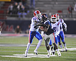 Ole Miss' Brandon Bolden (34) is tackled by Louisiana Tech's Jamel Johnson (20) in Oxford, Miss. on Saturday, November 12, 2011.