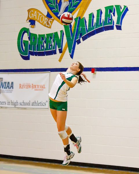 Green Valley Gators senior Emma Johnson serves to Del Sol from the back of her home gym.