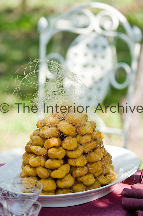 Detail of a tower of profiteroles on a platter