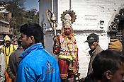 A Hindu man is dressed as Hanuman (monkey god) and seen begging outside the Pashupathi Nath Temple in capital Kathmandu, Nepal