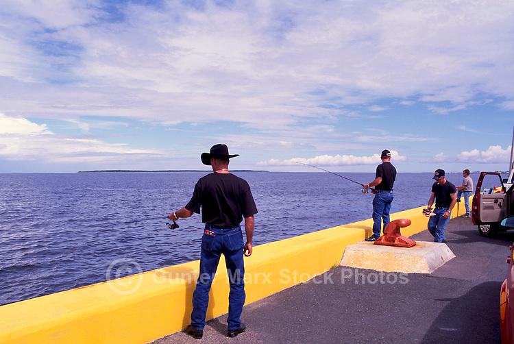 Caraquet, NB, New Brunswick, Canada - Fishermen fishing from Pier at Port du Caraquet