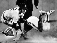 A's Billy North upends Boston's Doug Griffin to break up DP. (photo by Ron Riesterer 1973)