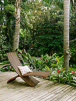 The decking extends into the lush vegetation of the garden offering peaceful areas for relaxation