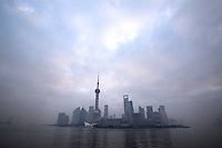 The Pudong business district of Shanghai is seen from the Bund, in Shanghai, China, on February 1, 2009. The Oriental Pearl tower is the tallest one on the left and the World Financial Center is the building with an hole in it. Photo by Lucas Schifres/Pictobank