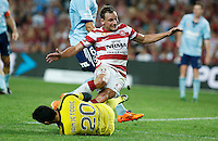 Sydney FC goalkeeper Vedran Janjetovic (bottom) fights for the ball against Wanderers Brendon Santalab during their A-League match in Sydney, March 8, 2014. VIEWPRESS/Daniel Munoz EDITORIAL USE ONLY