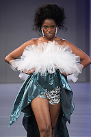 Model walks the runway in an outfit by Simone Rodrigues for the SISA Designs Spring 2012 fashion show, during Couture Fashion Week Spring 2012.