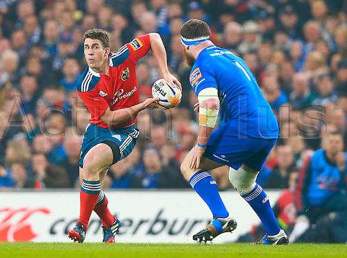 29.03.2014 Dublin, Ireland.  Ian Keatley (Munster) looks to pass out past Michael Bent (Leinster) during the RaboDirect Pro 12 game between Leinster and Munster from Aviva Stadium.