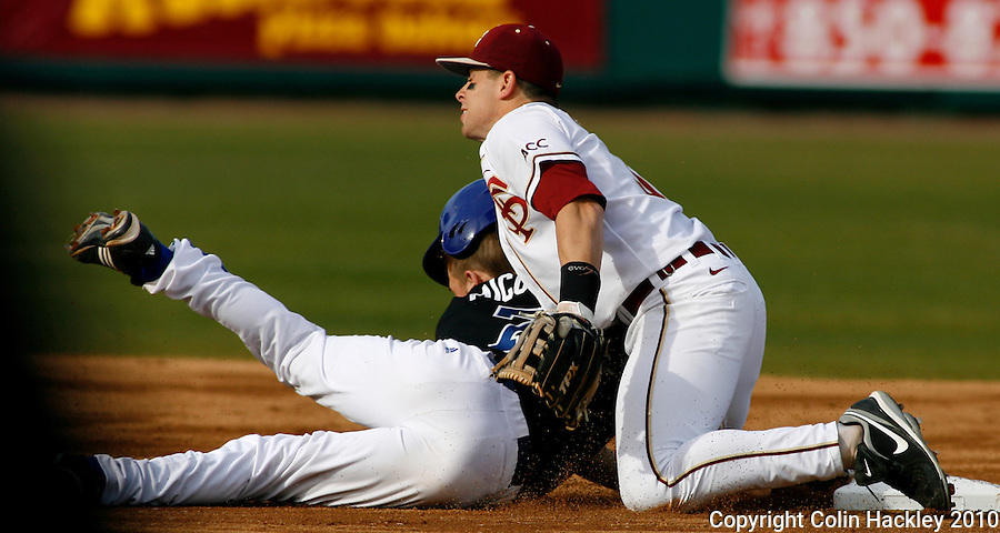 TALLAHASSEE, FL 10-FSU-GA.ST. BASE10 CH09-Florida State's Stephen Cardullo can't stop Georgia State's Mark Micowski from diving back safe at second base during the the first inning, Friday at Dick Howser Stadium in Tallahassee. The Seminoles beat the Panthers 11-3 in the 2010 season opener...COLIN HACKLEY PHOTO