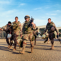 Spanish ISAF soldiers return after a patrol in Herat Province. ISAF (the International Security Assistance Force) is a peacekeeping mission affiliated to the United Nations (UN) and NATO.