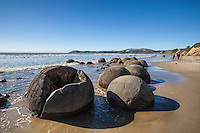 A large crack shows in the foreground of a group of the boulders at Moeraki, Coastal Otago, New Zealand - stock photo, canvas, fine art print