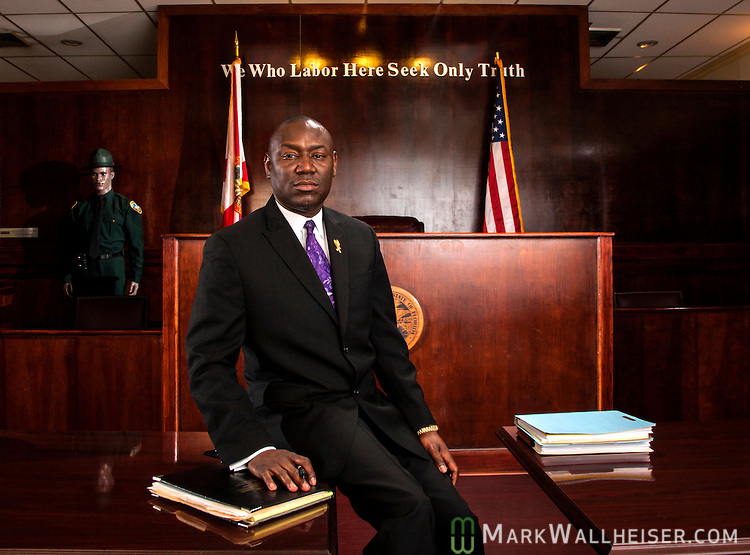 Tallahassee personal injury and civil rights attorney Benjamin Crump at his office in Tallahassee, FL.  Also pictured is Crump's wife Genae and daughter Brooklyn.