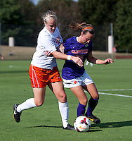 Mary Morgan (21) of Virginia fights for the ball with Emily Byorth (28) of Clemson at Klockner Stadium in Charlottesville, VA.  Virginia defeated Clemson, 3-0.