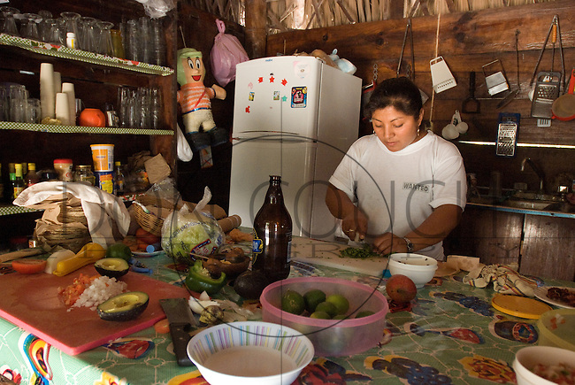 Inside the kitchen of a resturant in Punta Allen, Mexico, cooks prepare the food.