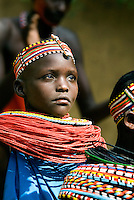 Samburu dancers at the Samburu Game Lodge. The dancers all belong to one Samburu village and live a short distance from the lodge. They are typically more adorned in traditional dress than other villages and sell their carvings and trinkets to tourists following their performance.