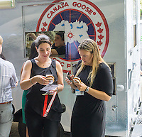 Ice cream lovers line up for a cool treat from the Coolhaus ice cream truck courtesy of the Canada Goose outdoor apparel company on Tuesday, September 1, 2015. The Canada Goose promotion was to promote the launch of their e-commerce site in the U.S. market. Their thousand dollar super-warm parkas were extremely popular and ubiquitous last winter and now you can order them online in the U.S.. (© Richard B. Levine)