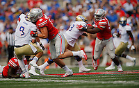 Ohio State Buckeyes cornerback Gareon Conley (8) sacks Tulsa Golden Hurricane quarterback Dane Evans (9) in the first quarter of an NCAA football game between the Ohio State Buckeyes and the Tulsa Golden Hurricane at Ohio Stadium on Saturday, September 10, 2016. (Columbus Dispatch photo by Fred Squillante)