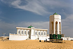 "The Seydina Limamou Laye Mausoleum sits on the coast of Senegal in the fishing village of Yoff.  Seydina Limamou Laye (1843-1909) was the founder of the Layène (meaning ""partisans of God"") brotherhood.  In front of the mausoleum, children wash at the well of Diamalaye (zem-zem holy water)."