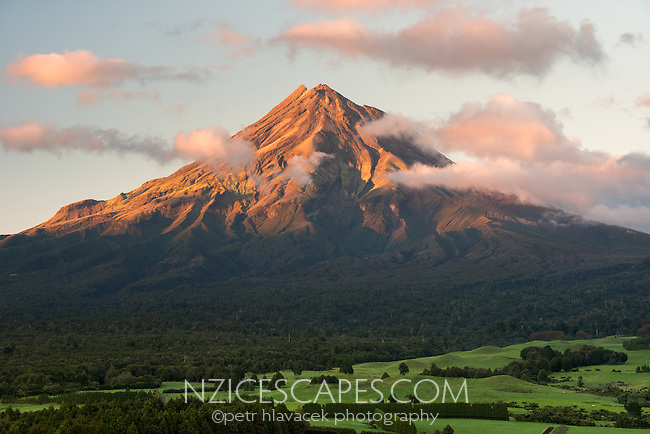 Sunrise over Taranaki, Mt. Egmont with farmland in foreground, Taranaki Region, North Island, New Zealand, NZ