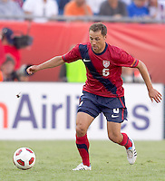 USA defender   Steve Cherundolo (6) at midfield. In a friendly match, Spain defeated USA, 4-0, at Gillette Stadium on June 4, 2011.