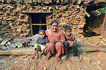 With her sons Safal, 5, and Sandesh, 10, Maya Thapalyia sits in front of the ruins of her home in Majhitar, Nepal. The family's home was damaged in an April 2015 earthquake that ravaged Nepal, but Dan Church Aid, a member of the ACT Alliance, has helped the indigenous community to rebuild, including providing Thapalyia's family with a transitional home.
