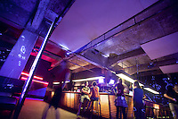 Interior at the Maria Am Ostbahnhof Club in the Friedrichshain district of East Berlin - a former industrial area abandoned after the Berlin Wall fell and East German manufacturing collapsed. The large factory spaces have now been converted into bars, restaurants, nightclubs, artists' studios, and performing arts spaces..