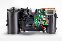 View Inside a disposable 35mm camera. The flash circuit board the viewfinder and the plastic film transportation mechanism can be seen. the Camera is normally covered by a plastic and cardboard shell.