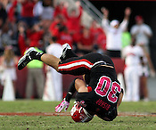 Brandon Bishop does a roll after missing a catch. NC State defeated Central Michigan 38-24 on Saturday, October 8, 2011 at Carter-Finley Stadium in Raleigh. Photo by Al Drago.