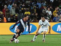 Second-half substitute Bennie Feilhaber turns the ball into the middle of the field while bing carefully watched by Slovenia's Aleksandar. The United States came from a 2-0 halftime deficit to Slovenia to earn a 2-2 draw their second match of play in Group C of the 2010 FIFA World Cup.