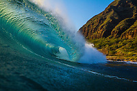 A backlit breaking wave at sunset, West O'ahu.