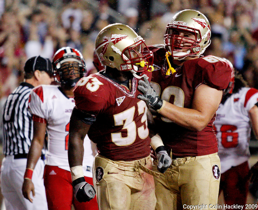 TALLAHASSEE, FL 9/12/09-FSU-JSUFB09 CH40-Florida State's Ty Jones, left, celebrates his second touchdown against Jacksonville State with Ryan McMahon during second half action Saturday at Doak Campbell Stadium in Tallahassee. .COLIN HACKLEY PHOTO