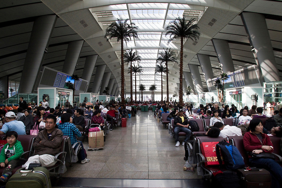 Passangers wait in Beijing's South train Station to ride a high speed rail or bullet train to Tianjin.