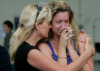 Peggy Matthis consoles her daughter Sara Matthis as her fiancee Chad Whitehouse boards a bus during a deployment ceremony for Marines from the Light Attack Helicopter Squadron 369 at Camp Pendleton, CA.  The Marines will engage in a Seven Month deployment to the Al Anbar Province in Iraq and will help support Operation Iraqi Freedom.