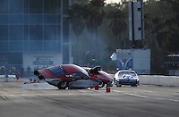 Mar. 9, 2012; Gainesville, FL, USA; NHRA pro mod driver Mike Janis (left) crashes alongside Roger Burgess during qualifying for the Gatornationals at Auto Plus Raceway at Gainesville. Janis would be unhurt in the incident. Mandatory Credit: Mark J. Rebilas-