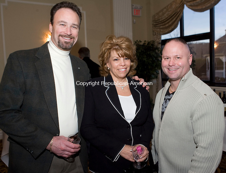 WATERBURY, CT - 12 MARCH 2009 -031209JT15-<br /> From left, John Dillon, with Linda Liotus and vice president of the Waterbury Police Union Steven Binette at the second annual &quot;Wishes from Waterbury&quot; wine and beer tasting to benefit the Make-A-Wish Foundation of Connecticut at the Villa Rosa in Waterbury on Thursday, March 12.<br /> Josalee Thrift Republican-American
