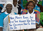 Women hold a sign at a church-sponsored women's peace rally in Juba, South Sudan.