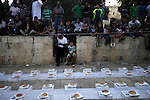 Palestinians prepare for Iftar (the evening meal during the Islamic month of Ramadan) to break their fasting at al-Aqsa mosque compound in the old city of Jerusalem, on July 31, 2013. Photo by Saeed Qaq