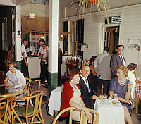 Montrowese Hotel Branford,Conn.<br /> Couples enjoying drinks at the outdoor lounge.