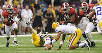 Daily Photo by Gary Cosby Jr.    ..DeQuan Menzie, Courtney Upshaw and Nico Johnson pursue the ball after Jordan Jefferson fumbled during the first half of the BCS National Championship Game between Alabama and LSU in the Superdome Monday night...................................