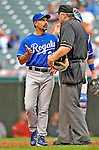 13 September 2008: Kansas City Royals' Manager Trey Hillman discusses a play on field with the officials during a game against the Cleveland Indians at Progressive Field in Cleveland, Ohio. The Royals defeated the Indians 8-3 in the first game of their rain delayed double-header...Mandatory Photo Credit: Ed Wolfstein Photo