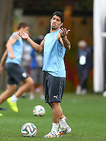 Luis Suarez of Uruguay gestures as he trains in the Arena Corinthians, Sao Paulo ahead of his sides Group D crunch fixture vs England tomorrow