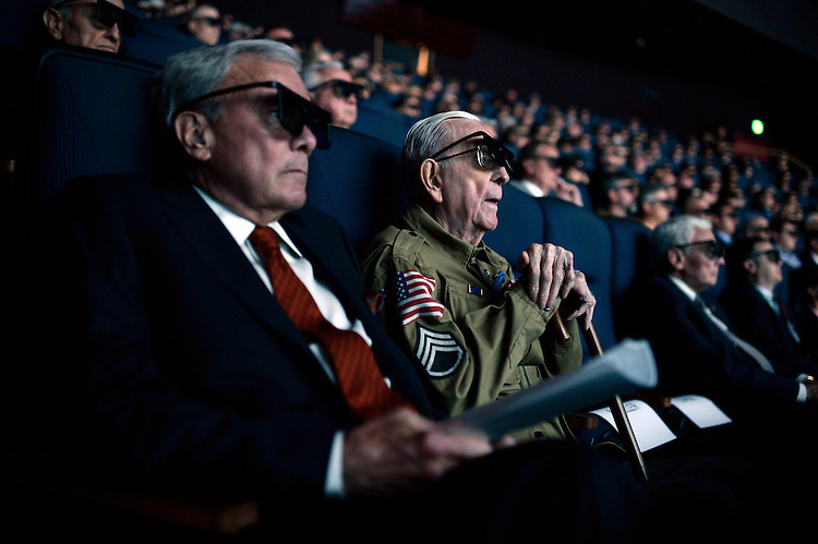 """UNITED STATES - MAY 19: Tom Brokaw and World War II veteran Tom Blakey, 93, of New Orleans, watch a screening of """"D-Day 3D: Normandy 1944,"""" which Brokaw narrated, at the IMAX theater in the the Smithsonian Air and Space Museum, May, 19, 2014. Blakey jumped into Normandy on D-Day with the 82nd Airborne. (Photo By Tom Williams/CQ Roll Call)"""