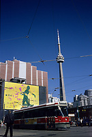 A tramway pass in front of an I Pod giant billboard ad on King and Spadina street<br />  the CN Tower is in the background.<br /> <br /> The CN Tower, located in Toronto, Ontario, Canada, is the world's tallest freestanding structure on land, standing 553.33 meters (1,815 ft 5 in) tall. It is considered the signature icon of the city, attracting more than two million international visitors annually<br /> <br /> Photo : Pierre Roussel - Images Distribution