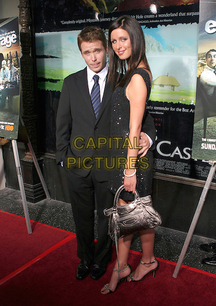 KEVIN CONNOLLY & NICKY HILTON.Premiere of HBO's series ENTOURAGE held at the El Capitan Theater, Hollywood, California.May 25th, 2005.Photo Credit: Zach Lipp/AdMedia.full length arm around waist black suit purple metallic purse bag.www.capitalpictures.com.sales@capitalpictures.com.© Capital Pictures.