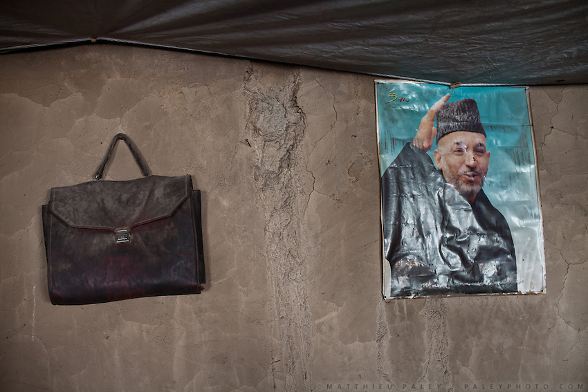 President Karzai on the wall of a mud house..In and around the campment of Kyzyl Qorum, campment of the former deceased Khan, Abdul Rashid Khan..Trekking with yak caravan through the Little Pamir where the Afghan Kyrgyz community live all year, on the borders of China, Tajikistan and Pakistan.