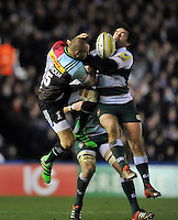 Ross Chisholm of Harlequins competes with Oli Bryant of Leicester Tigers for the ball in the air. Aviva Premiership match, between Harlequins and Leicester Tigers on February 19, 2016 at the Twickenham Stoop in London, England. Photo by: Patrick Khachfe / JMP